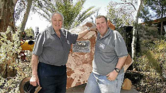FATHER AND SON OPERATION: Eddie and Eddie White from Allansford have a 27m public weighbridge in their backyard.