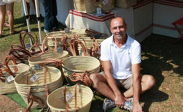 Andrew Taylor with his hand-woven market baskets sold under the Farmer Drew name.