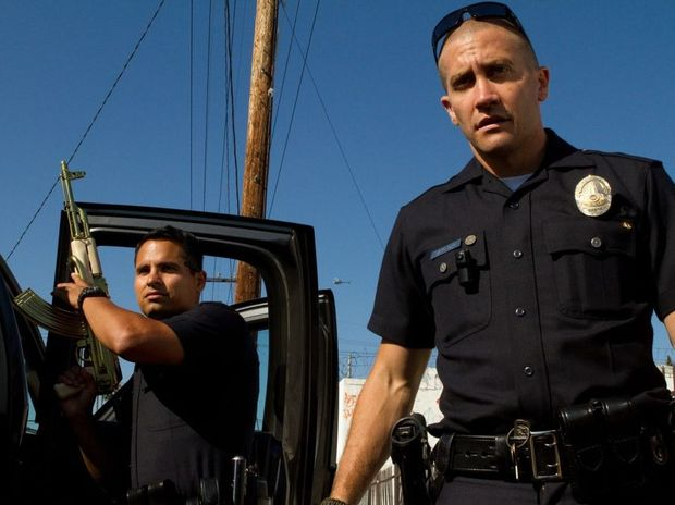 Michael Pena, left, and Jake Gyllenhaal in a scene from the movie End of Watch.