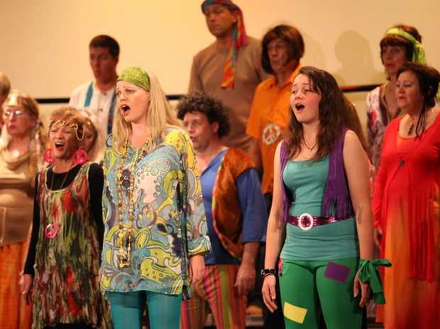 Singers warm up their vocal chords for the Christmas Variety Concert. Photo: Contributed