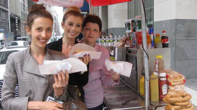 Alexandra Ristway, her sister Olympia, and mother Jane indulge in some American hot dogs. Photo Contributed