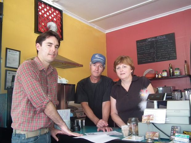 Division 10 councillor George Seymour discusses the plans with Les and Robyn King from Swell Cafe.