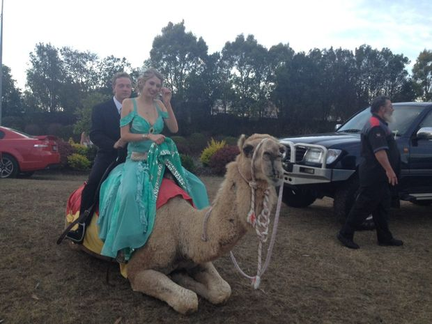 Eddie Gilson and Avena Osborn arrive at the Maryborough State High School formal on the back of a camel.