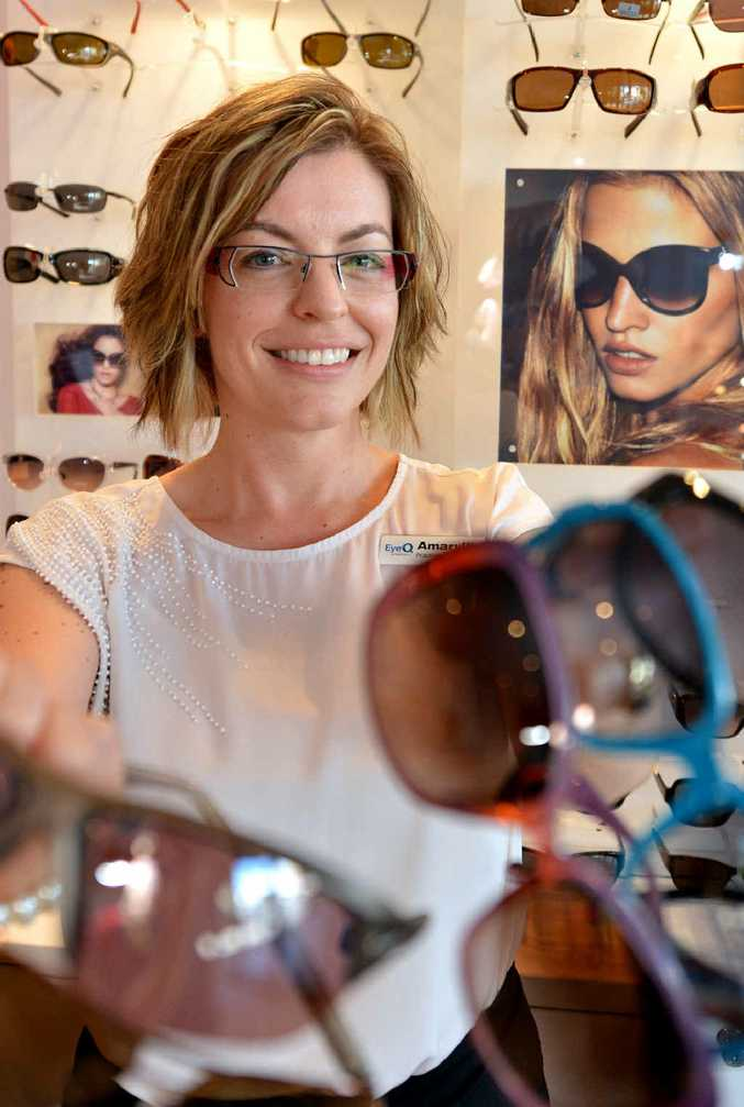 EyeQ Optometrists' practice administrator Amaryllis O'Hara shows off stylish sunglasses recommended for eye protection.