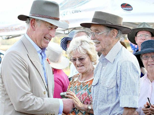 WARM WELCOME: Prince Charles jokes with locals at Longreach.