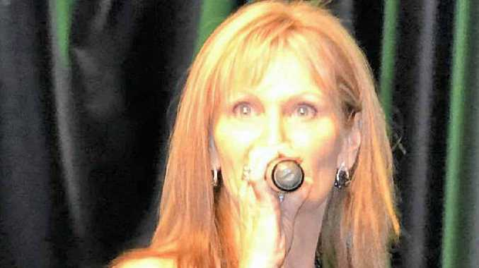 STAGE PRESENCE: Erin Hilton belts out a tune at the Queensland Champion of Champions festival.