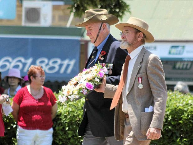 Warwick RSL Sub-branch committee members Tom Bryant and John Greacen laid a wreath at the Warwick Cenotaph last year. Mr Greacen will be the guest speaker at this year's Remembrance Day Service at 10.40am tomorrow.