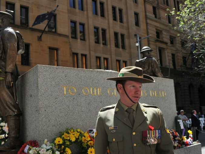Victoria Cross winner, Corporal Daniel Keighran, stands by the cenotaph following a Remembrance Day ceremony in Sydney on Sunday, Nov. 11, 2012. Remembrance Day celebrates the end of World War I and pays tribute to the members of their armed forces who have died in the line of duty. (AAP Image/Paul Miller)
