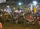 Jay Marmont (centre) goes around Ben Townley as he falls in the Pro Open.