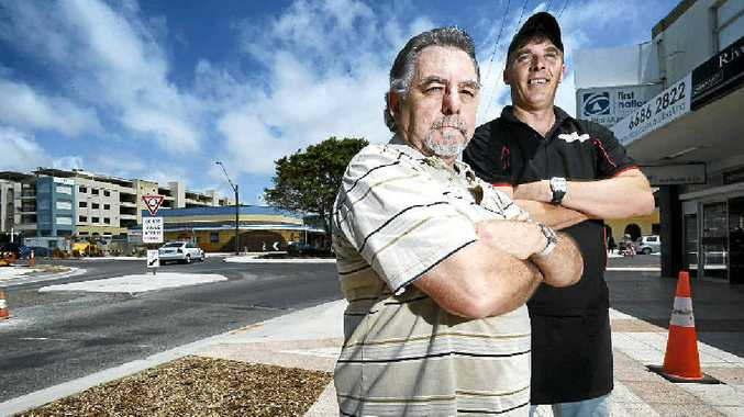 FEELING PINCH: River St jewellery shop owner Gary Packham and burger bar owner Trent Corrigan have both felt considerable loss in their trade.