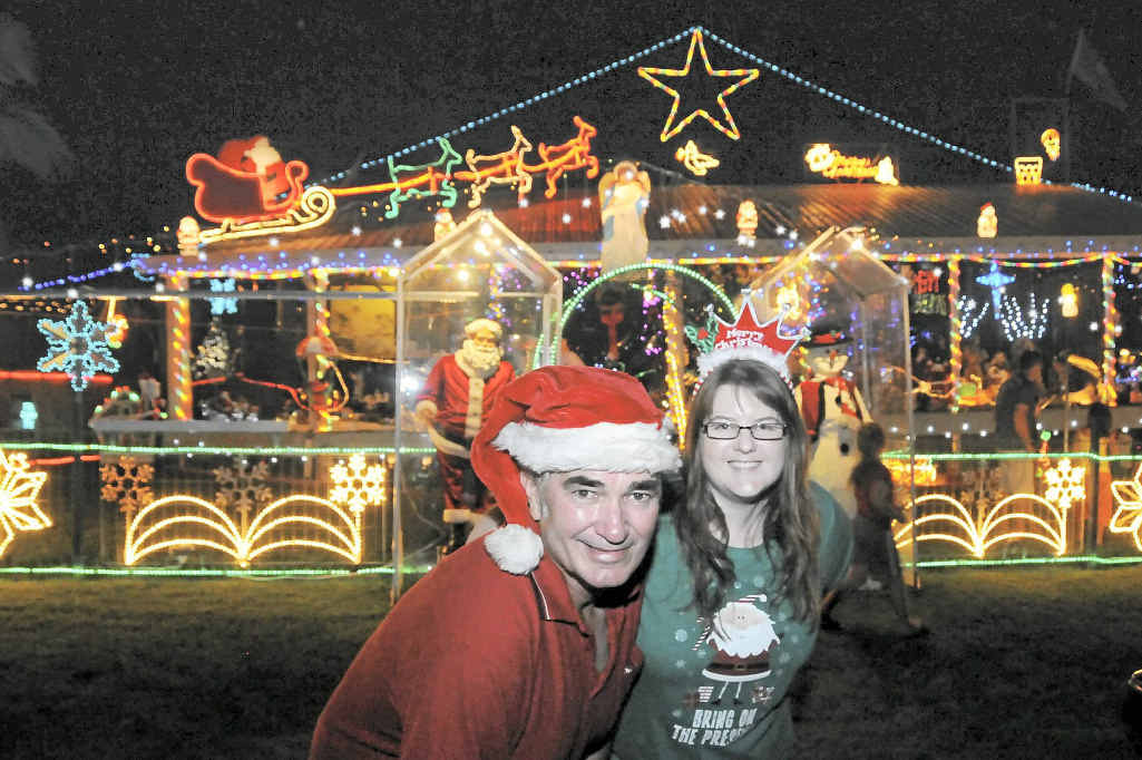 A previous Christmas lights winner Ray Dole and his daughter Belinda Rimmington outside Ray's Fairview Drive Christmas lights display.