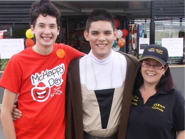 Gympie's Geek Jason Newell (left) at McHappy Day at his home town McDonald's with Jarred Ware and Kellee Harragon.