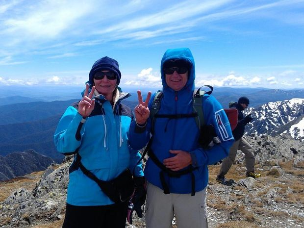 Nigel and Leanne Phillips celebrate reaching the second of their peaks, the 2195 metre high Mount Twynam.