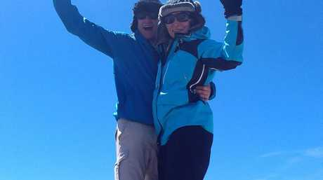 Leanne and Nigel Phillips celebrate climbing the highest mountain in Australia.