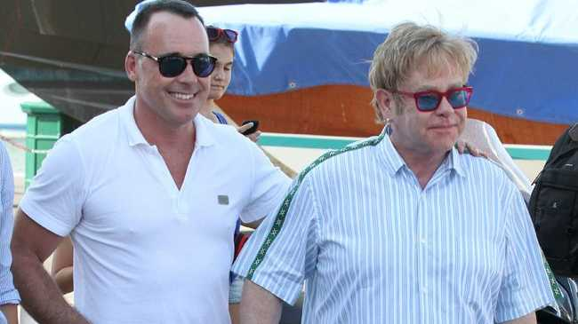 Elton John and David Furnish with Zachary