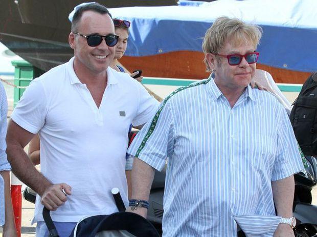 Elton John and David Furnish with Zachary