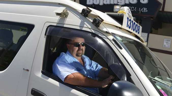 Blue and White taxi driver, Jim Redman.