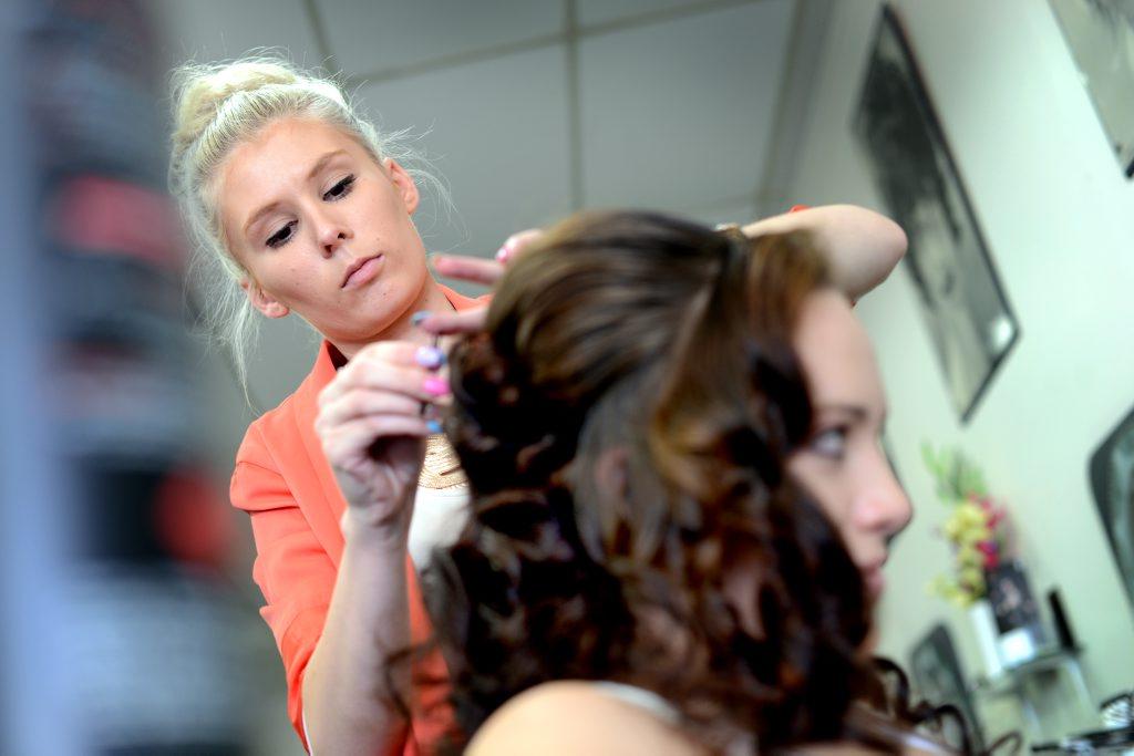 Hairdresser Tash Cox styling Hannah Richards hair.