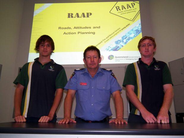 Firefighter Mark McGrath with Year 12 Xavier Catholic College students Blake Hagar and Alex Jacob.