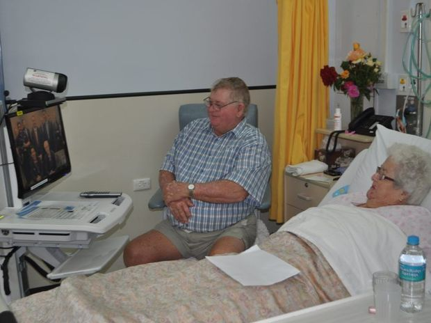 Bruce and Annette Maunder watch as Professor Len Gray and ministers tune in froom the PA Hospital in Brisbane. Photo Georja Ryan / Warwick Daily News