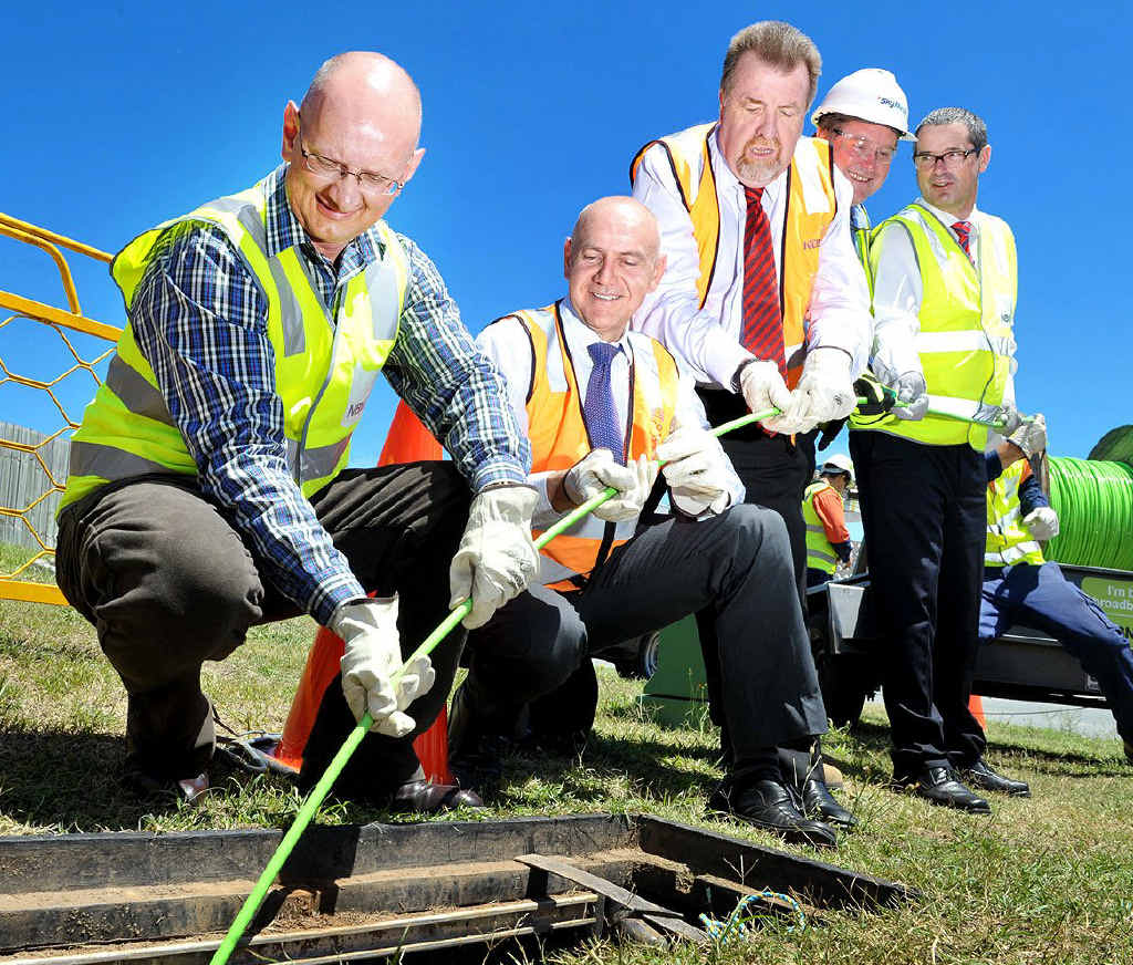Shayne Neumann MP, Bernie Ripoll MP, Cr Paul Tully, Skymesh managing director Paul Rees and Communications Minister Stephen Conroy lay the first cable of the National Broadband Network in Goodna yesterday.