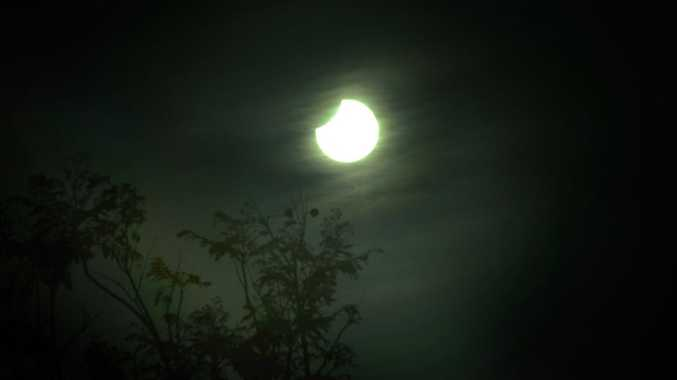 The sky is darkening over Gladstone as the moon passes in front of the sun.