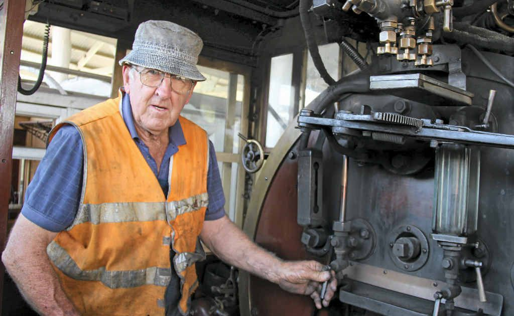 Fitter John Brady checking the water levels in the steam train ahead of tomorrow's trip to Wallangarra.