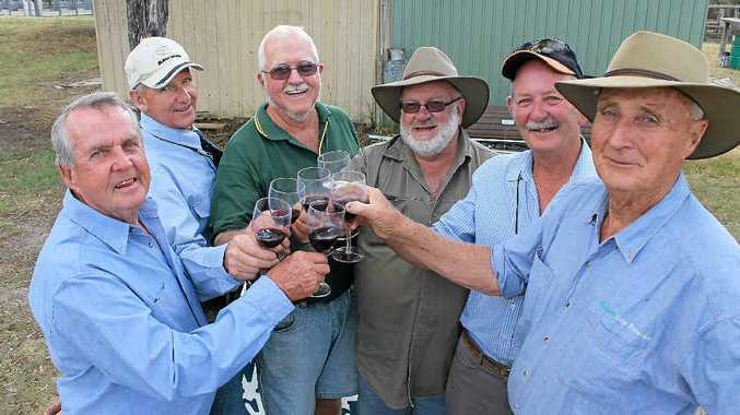 Men's Shed members Paul Crowe, John Boucher, Nev Winter, Kev Armstrong, Justin Liddy and Jim Wilkinson toast to a successful Symply Red launch.