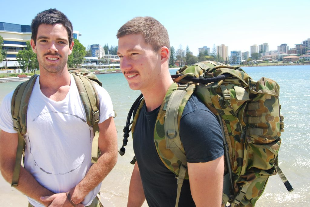 Ben Harris and Sam Weir heading off on their fundraising mission. Photo: Mairi Manley