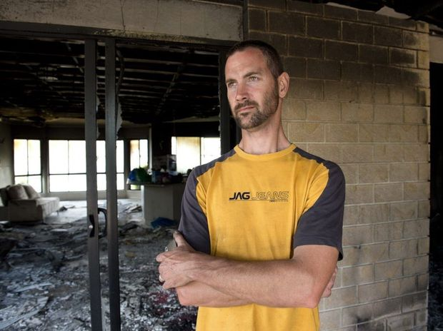 Adam Stiller at his Rangeville house that was seriously damaged by fire.