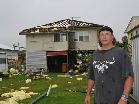 Bill Smith in his backyard in Alfred Street, Woodburn. His roof was blown off in the huge storm that smashed into the small village on Saturday night.