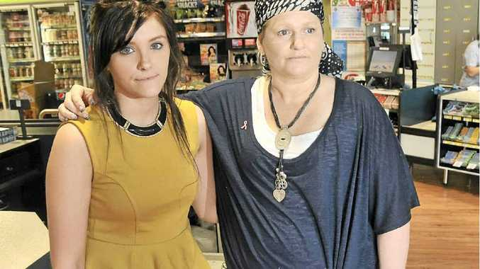 ROBBED OF MEMORIES: Symmon Sidney (right) with her friend Jess Quinn at the Mt Coolum IGA.