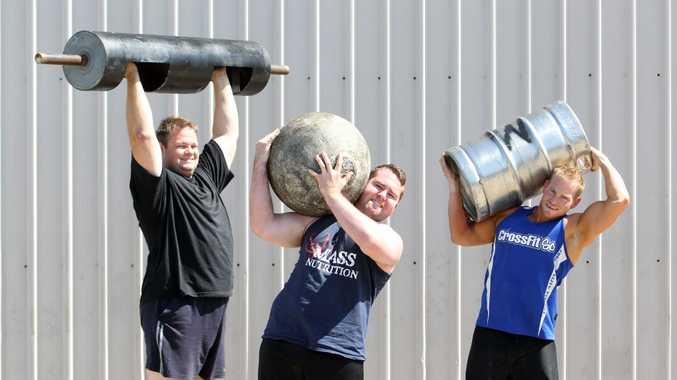 Glasshouse Mountains Strongman Challenge 3 at Fitness Plus, Beerwah. (L to R) Event MC Tim O'Shea with competitor's Jarrad Gaudern and Kurt Southam. Photo: Cade Mooney / Sunshine Coast Daily