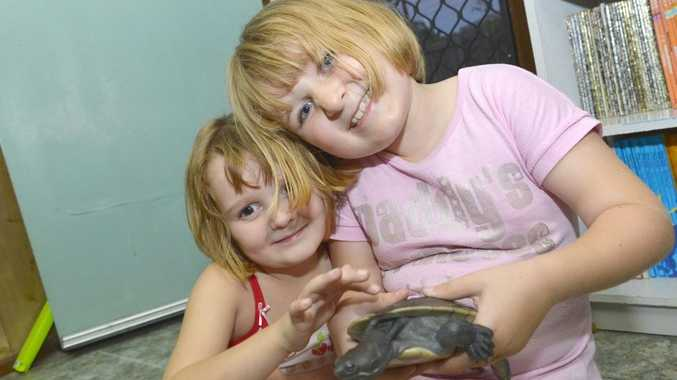 Lily Smith, 5 and sister Ruby, 7 show off their pet turtle, Big Tom.