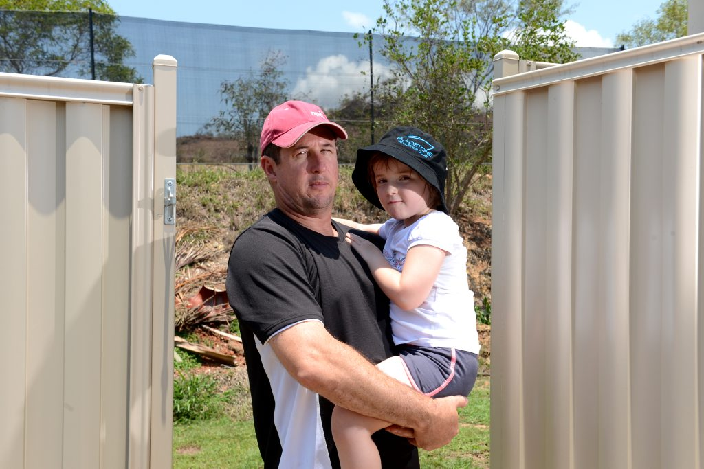 Robert Bragge with daughter Michaela Bragge, 4, is not happy about the procedure of the developement due to lack of communication.