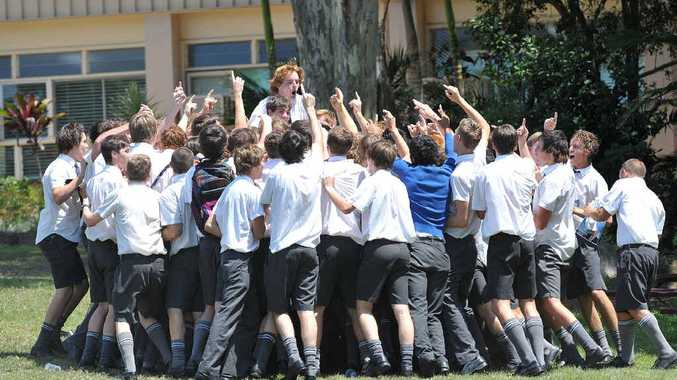JUMPING FOR JOY: St Edmund's College students celebrate their graduation.