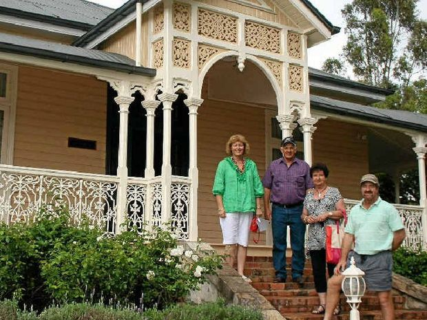 Linda Weymouth, Henry and Rosemary Baillie and Bill Weymouth from the Millmerran Historical Society stand on the steps of Deconlay overlooking the gardens.