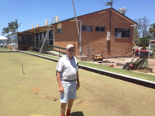Woodburn Bowling Club president John Forshaw pictured on one of the greens damaged by Saturday's storm. To his right is the slab that used to sit under the club's shed.