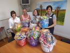 Val Radloff, Maree Stebbings and Leeanne Spencer from Anglicare Gladstone thanks Kristie McDermott and the rest of the ANZ team for their donation of Christmas hampers.
