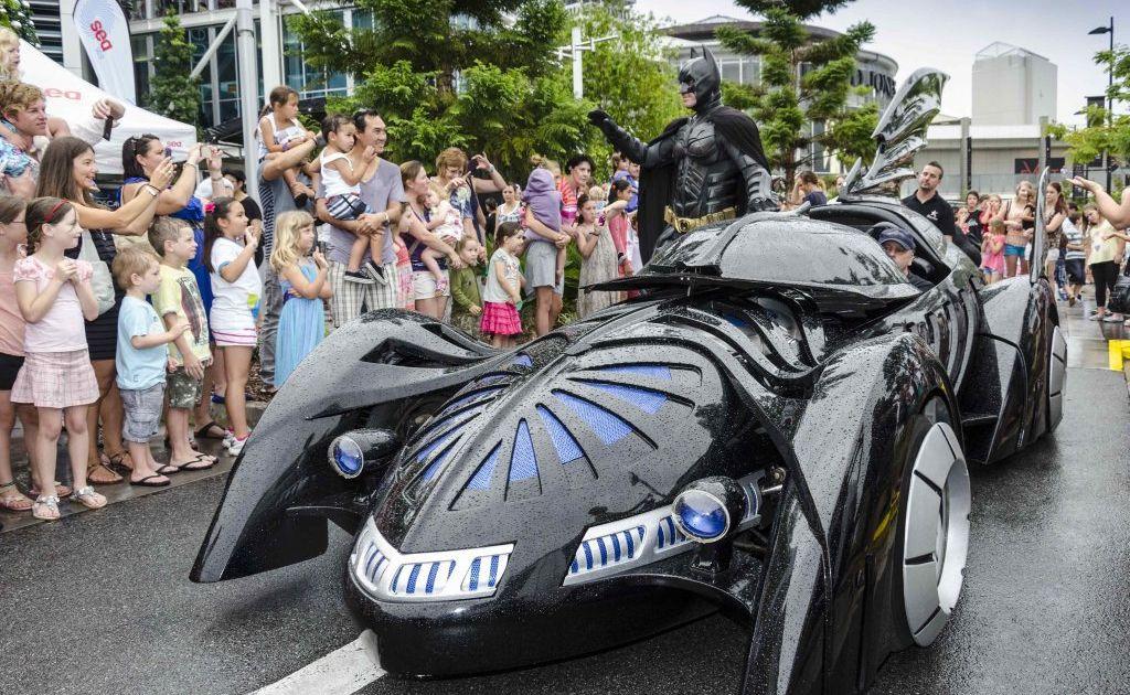 Batman arrives in his bat mobile.