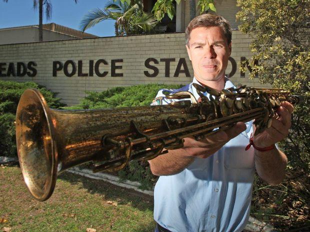 Senior Constable Luke Catt with the mystery Saxophone Photo: Blainey Woodham / Daily News