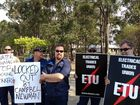 PROTEST: Eletrical Trades Union delegate Scott Reichman with demonstrators outside the Sunwater offices in Enterprise St on Tuesday. Photo Christina Ongley / NewsMail