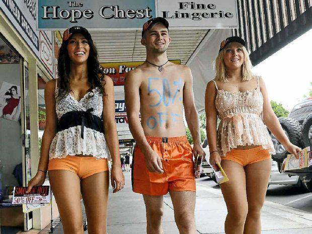Grafton models Lou Bloomer, Jack Foulstone and Eleni Hayman walk the streets promoting Smokin' Hot underwear. Photo: Debrah Novak