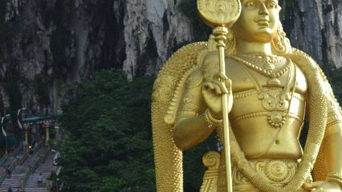 The famous Batu Caves and the infamous staircase to an ancient Hindu temple overlooked by the large golden statue of Lord Murugan.