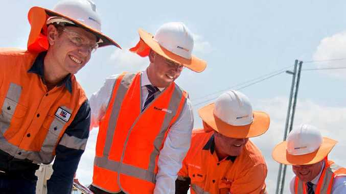 BMA's Gordon Carlyle (left), Transport Minister Scott Emerson, Pacific National Coal director David Irwin and Pacific National Coal Queensland general manager Geoff Featherstone turn the first sod for the Nebo Train Maintenance Facility expansion.