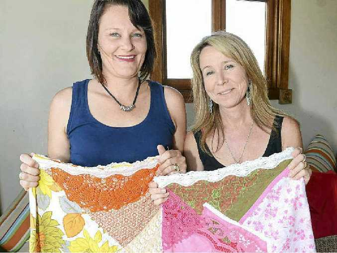 Ranae Panoho and Nicky McAleer making hand-crafted vintage skirts.