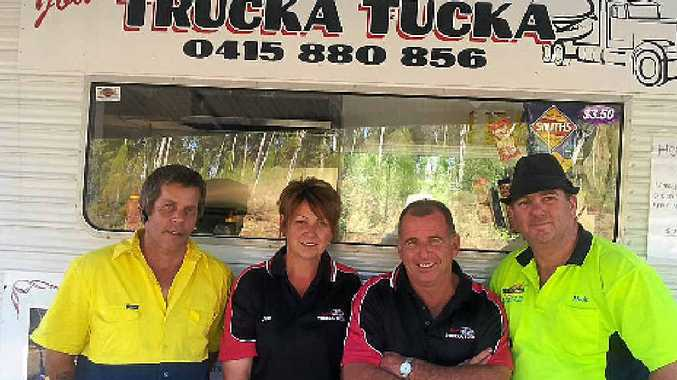 GRAB A FEED: Drivers Tom Buckler (left) and Michael Hogg (right) with Joan and Dave Redfern.