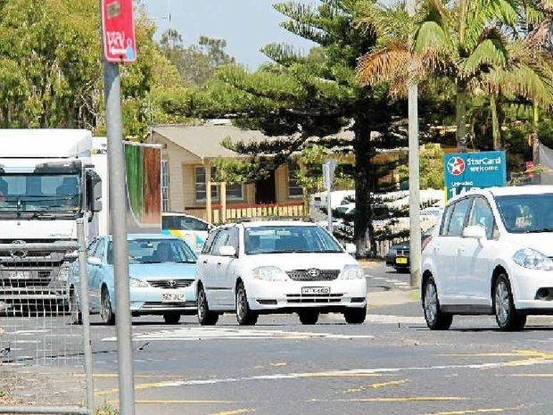 THEY KEEP COMING: Traffic rolls into Byron Bay last Friday morning.