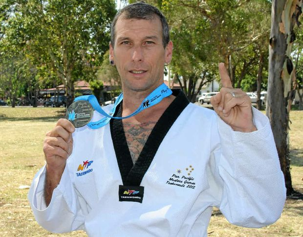 FIGHTING SKILL: Guy Hubert fought hard to claim gold in the tae kwon do at the 8th Pan Pacific Masters Games on the Gold Coast.