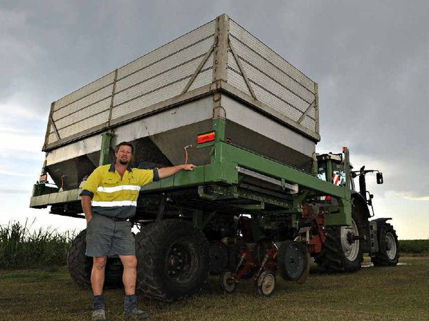 GOOD DESIGN: Ag-Culture Enterprises' Peter Watson with the direct drill machine, which will help farmers cut costs in spreading fertilisers.